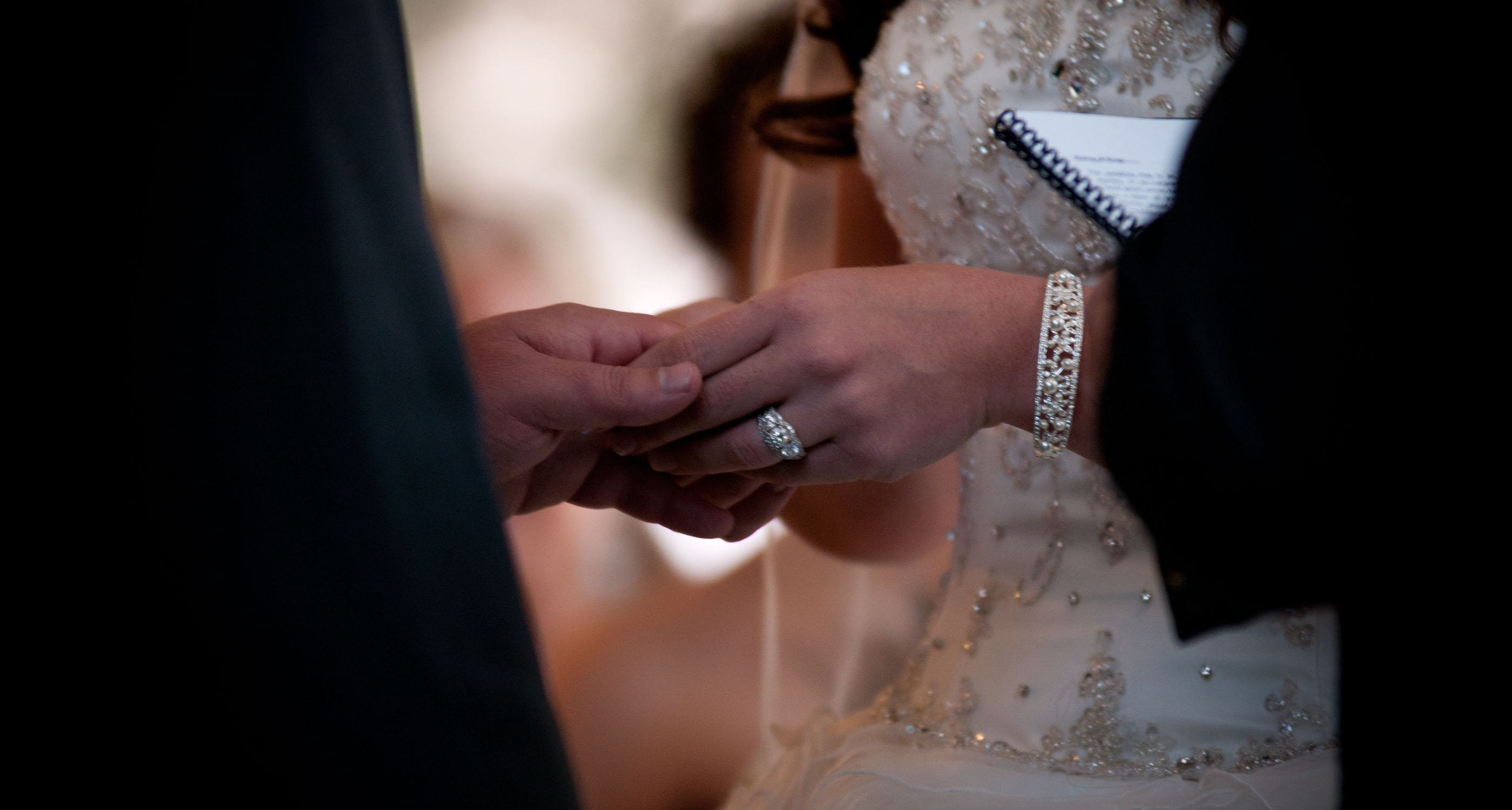close up of holding hands during ceremony